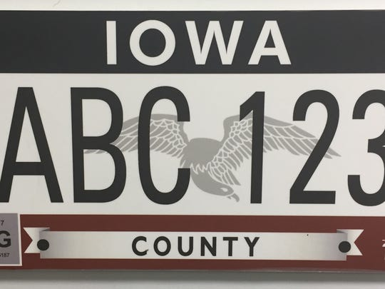 """This plate is called, """"Flying Our Colors,"""" and was inspired by Iowa's state flag, featuring red, white and blue colors and a silver-grey image of the eagle on the state flag."""