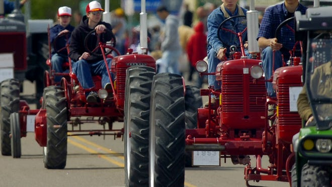 Antique tractors make their way down Main Street in Conrad during a previous Whoop-up Days parade.