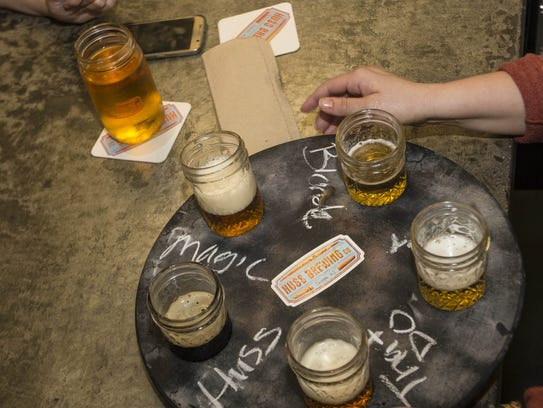 MollyJo Mow, a bartender at Huss Brewing Co., loads
