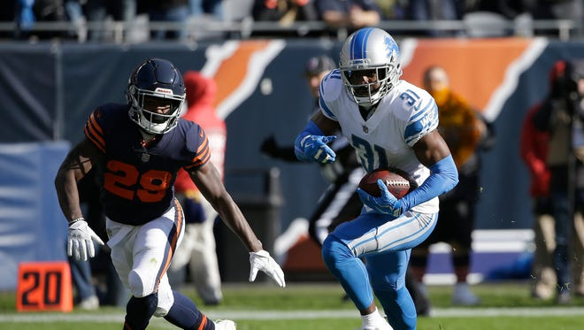 Lions defensive back DJ Hayden runs to the end zone against Bears running back Tarik Cohen after picking up a fumble by quarterback Mitchell Trubisky during the first half of the Lions' 27-24 win on Nov. 19, 2017 in Chicago.