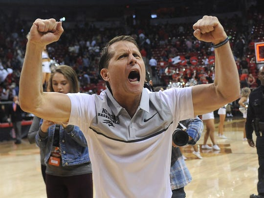 Nevada head coach Eric Musselman reacts after defeating