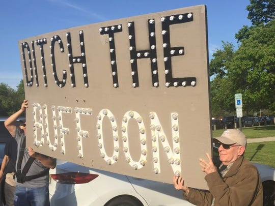 Jack Zaraya, a Freehold retiree, holds a protest sign outside Rep. Tom MacArthur's town hall meeting in Willingboro.