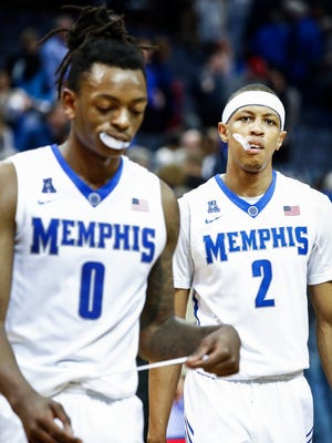 Memphis teammates Kyvon Davenport (left) and Jimario Rivers (right) walk off the court after a loss to Cincinnati in January.