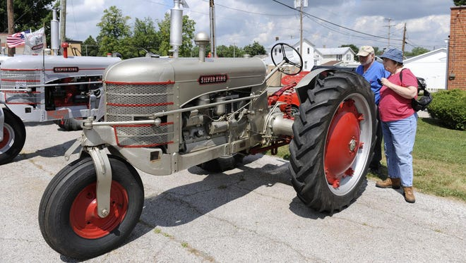 In this file photo, Dan Foor of Groveport and friend Carol German of Columbus look over a Silver King tractor at the Plymouth Silver King Festival in 2009.
