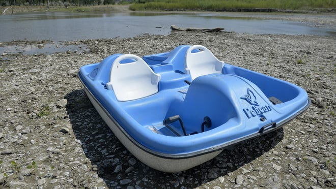 A pedal boat sits along the Mussleshell River on the Browning Ranch. Drought conditions in eastern are some of the worst in recent memory.