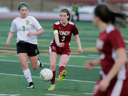 Fond du Lac's Shea-Lynn Gerred kicks the ball up field as Oshkosh North High School's Lindsey Knepfel challenges.   Oshkosh North Spartans played host to Fond du Lac Cardinals in girls soccer April 24, 2018.  The match was held at JJ Keller Field at Titan Stadium.  North won 3 to 0.Joe Sienkiewicz/USA Today NETWORK-Wisconsin