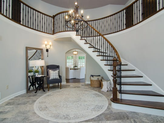 The home's front entry was completely redesigned and opened up to take advantage of the space and provide a beautiful entryway.