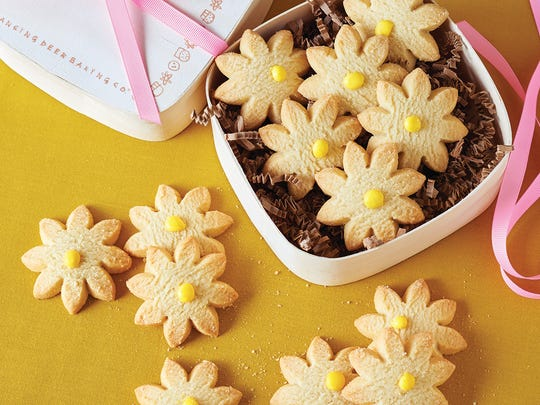 Lemon shortbread daisies from Dancing Deer Baking Co. make a cheerful hostess gift.