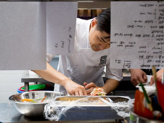 Executive Chef Seung Choi puts the finishing touches on a dish.