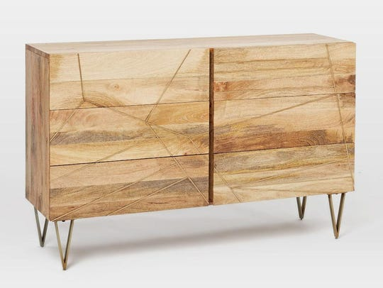 Made with raw mango wood, this dresser can be found