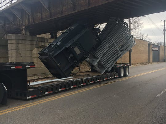 Semi crashes into an overpass on Paddock Road.