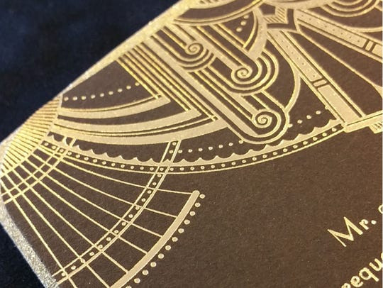 Metallic details on wedding invitations add drama.