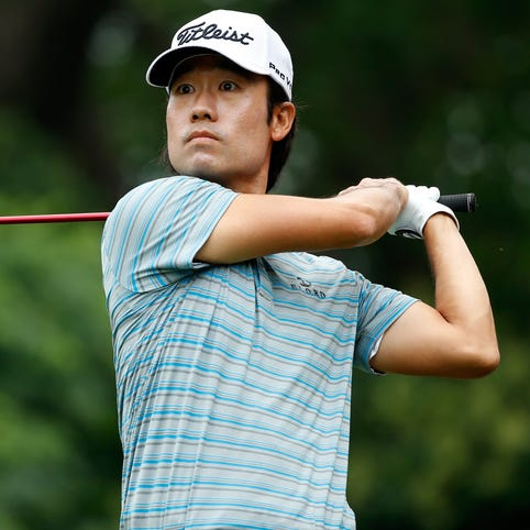 Kevin Na hits a shot from the 9th tee during the third