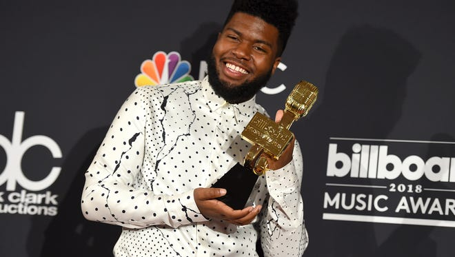 Khalid poses in the press room with the award for top new artist at the Billboard Music Awards at the MGM Grand Garden Arena on Sunday in Las Vegas.