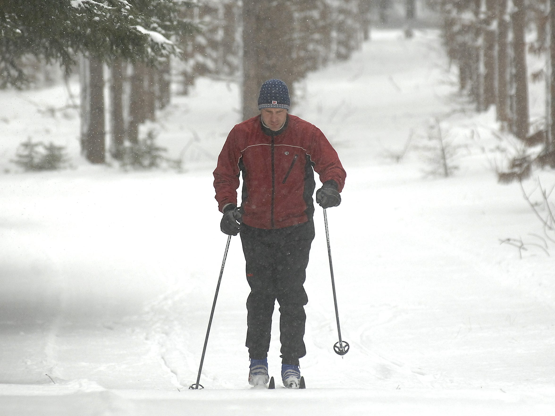 Tim Schwartz of Rib Mountain gets in some cross country skiing under perfect conditions at Nine Mile Recreation Area because of the snow storm  in 2013.