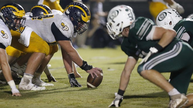 Prince Avenue Christian's Daniel Parrish (54) gets ready to start a drive during a GHSA high school football game between Prince Avenue Christian and Athens Academy in Athens, Ga., Friday, Nov. 3, 2017.