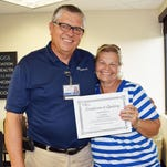 """Jim Brawner and Evon McKim. McKim received her """"Certificate of Quitting"""" from Brawner after completing Brawner's tobacco cessation class and conquering her smoking habit."""