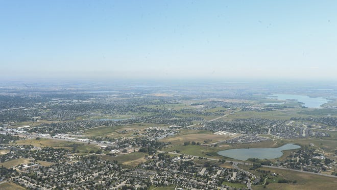 An aerial photo shot Tuesday shows Fort Collins. The city's population is expected to rise from an estimated 155,000 today to 250,000 by 2040.