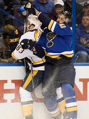 Predators center Vernon Fiddler (83) and Blues defenseman Robert Bortuzzo (41)  tussle along the boards during the first period in game 2 of the second round NHL Stanley Cup Playoffs at the Scottrade Center Friday, April 28, 2017, in St. Louis, Mo.