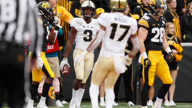 Purdue wide receiver David Bell (3) celebrates with teammate Milton Wright (17) after catching a 7-yard touchdown pass during the first half of an NCAA college football game against Iowa, Saturday, Oct. 19, 2019, in Iowa City, Iowa. (AP Photo/Charlie Neibergall)