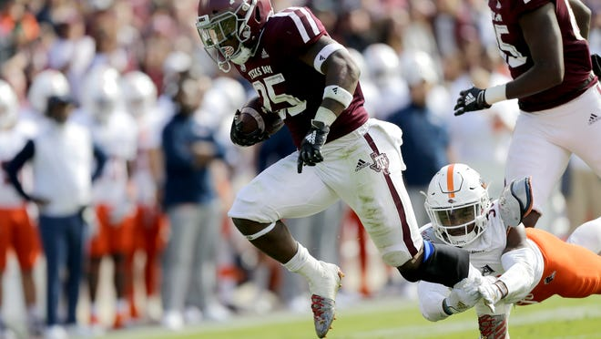 Texas A&M running back Cordarrian Richardson (25) breaks free from a tackle from a UTSA defender for a 19 yard touchdown run during the first quarter of an NCAA college football game, Saturday, Nov. 2, 2019, in College Station, Texas. (AP Photo/Sam Craft)