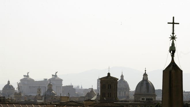 The Rome's skyline is seen from the St. Damaso balcony at the Vatican, Wednesday, Sept. 16, 2020.
