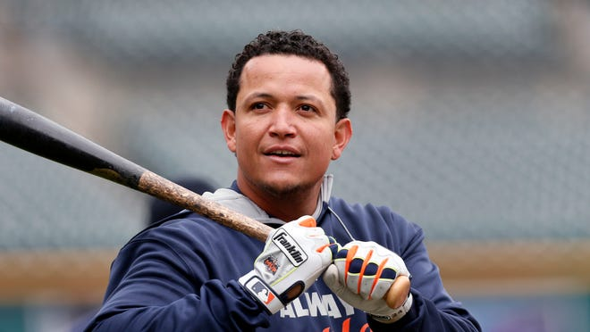 Detroit Tigers' Miguel Cabrera warms up during practice Saturday, Oct. 4, 2014, in Detroit, in preparation for Sunday's Game 3 of baseball's American League Division Series against the Baltimore Orioles. Baltimore leads the best-of-five games series 2-0. (AP Photo/Paul Sancya)