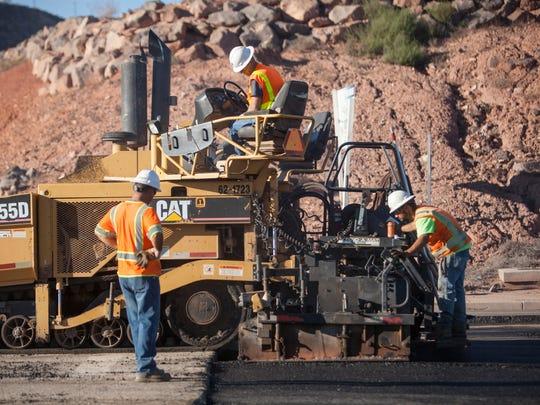 Road construction crews work on Black Ridge Drive Thursday, Nov. 11, 2015.
