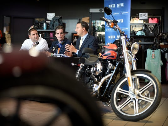 Congressman Ryan Costello, far right, is joined at a table with Douglass Henry, (far left) of Henry Molded Products, and Kevin Shivers, (center) Executive State Director NFIB/PA, for a discussion on small business needs held Friday at White's Harley Davidson in North Lebanon Township.