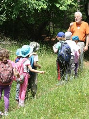 Ed Bieber leads a group of Nature Place campers on