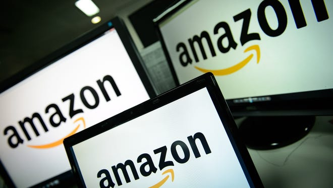 A picture shows the logo of the online retailer Amazon displayed on computer screens. On Monday, June 19, 2017, Amazon announced it plans to purchase Whole Foods.