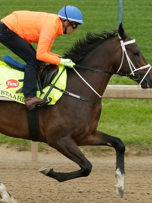 Jockey Christophe Soumillon rides Kentucky Derby entrant Mubtaahij during a workout at Churchill Downs Thursday, April 30, 2015, in Louisville, Ky. (AP Photo/Charlie Riedel)