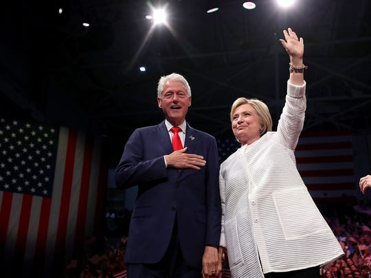 The Clintons greet supporters during a primary night event on June 7, 2016, in Brooklyn.