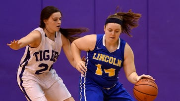 Lincoln's Kerrigan Neff moves the ball against Hagerstown's Victoria Pierson Thursday, Jan. 12, 2017, during a girls basketball game in Hagerstown.