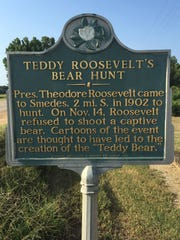This sign, which is dedicated to a bear hunt where former President Theodore Roosevelt refused to shoot a restrained bear, is about five miles from where three men encountered a bear during a dove hunt Saturday.