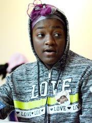 Joy Nkechi Agummadu,13, of York City, talks while attending