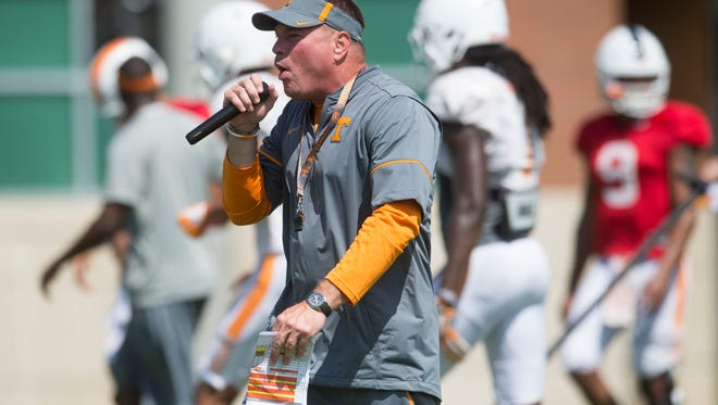 Vols coach Butch Jones yells during practice Aug. 18, 2017.