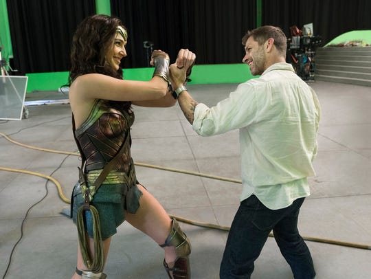 Gal Gadot and director Zack Snyder share a moment on