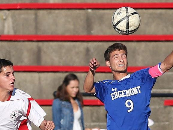 Edgemont's Drew Simon (9) heads a ball during a 1-0 win at Sleepy Hollow on Wednesday, Oct. 7.