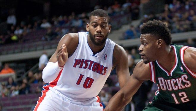 Milwaukee Bucks forward Jeff Adrien defends Detroit Pistons forward Greg Monroe, left, at the Palace of Auburn Hills.