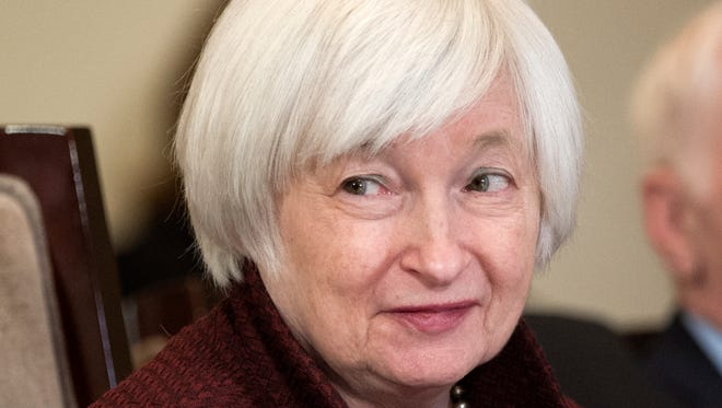 Federal Reserve Board Chair Janet Yellen oversees an open meeting in Washington on Dec. 15.