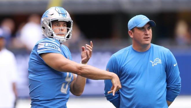 Matthew Stafford warms up before an exhibition against the Colts as Jim Bob Cooter looks on Aug. 13, 2017 at Lucas Oil Stadium in Indianapolis.