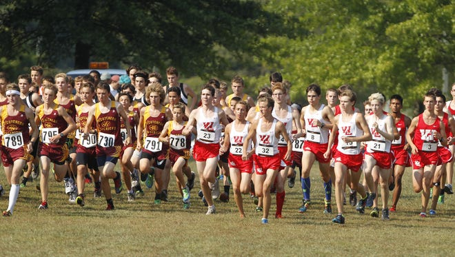 Runners from McCutcheon (left) and West Lafayette take off at the start of the City/County meet on Sept. 8 at Tippecanoe Amphitheater.  They'll be back there on Saturday for the sectional meet.