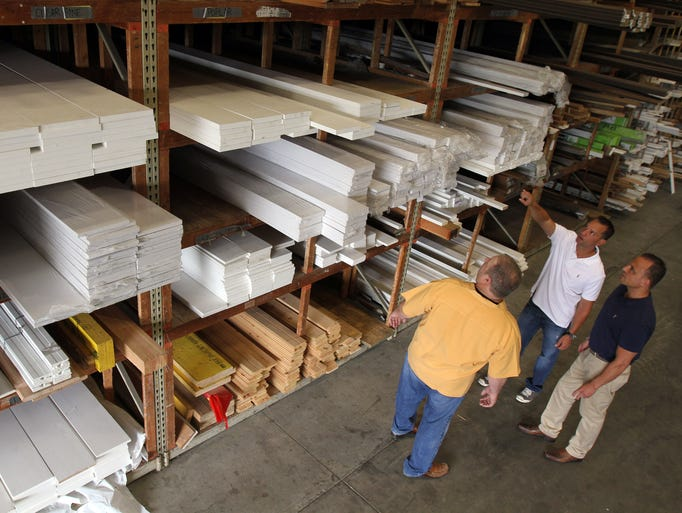 (L-R) Robert Morgenroth, manager of Park Union Building Supplies, Michael Colaiacovo and Todd Sawyer, both owners of Eastern Contractor Services and the new owners of Park Union Building Supplies, stand in the warehouse of Park Union Building Supplies in Randolph, NJ Wednesday July 16, 2014.  Staff photo Tanya Breen