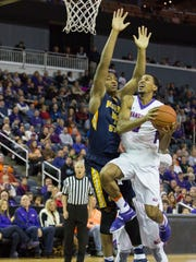 UE's Ryan Taylor lifts the ball up to score as Murray State's defensive player tries to make the block during Saturday afternoon's game at the Ford Center.