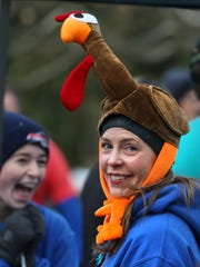 Wendy Dwyer Albano, Rochester, sports a festive turkey hat as she awaits the start of the 46th annual Webster Turkey Trot held Thursday, Nov. 23, 2017 at Webster Park. Runners, 4,677 officially registered, ran in either the 4.4 or 2.5 mile runs.