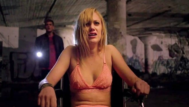 """Hugh (Jake Weary) passes a curse along to Jay (Maika Monroe) by having sexual intercourse with her in """"It Follows."""""""