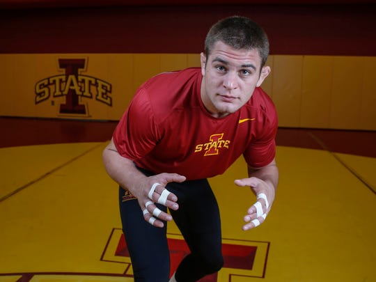 Iowa State junior Pat Downey III of Baltimore, Md., poses for a photo during Iowa State University wrestling media day in Ames on Tuesday, Oct. 18, 2016.