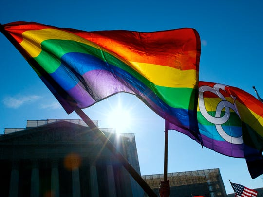 Gay pride flags fly at the Supreme Court on March 27,