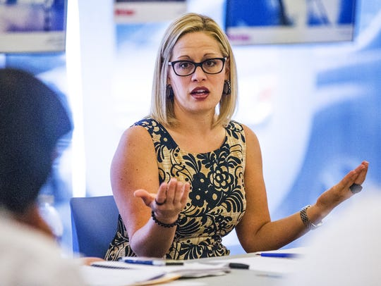 Rep. Kyrsten Sinema holds a roundtable discussion at